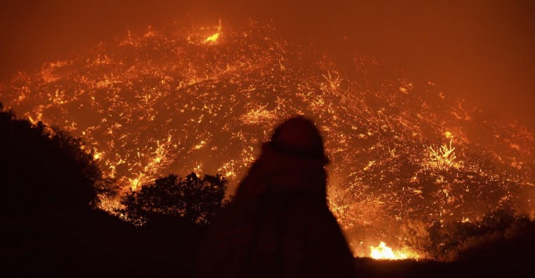 Firefighters battle the Powerhouse wildfire at the Angeles National Forest, with the fire now having destroyed several homes near the Lake Hughes area in California early Sunday morning June 2, 2013. The Powerhouse Fire remained at 15 percent containment after ravaging over 5,600 acres of the forest by Saturday evening. (Gene Blevins/Reuters)