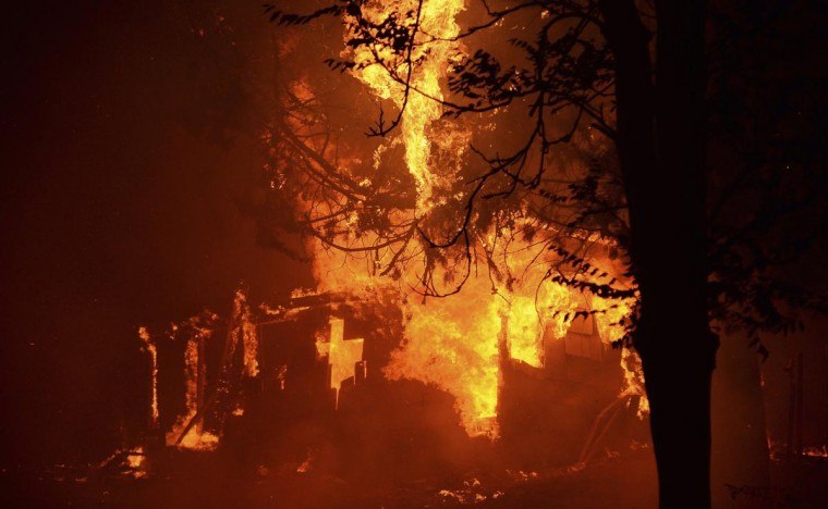 Fire engulfs a house as firefighters battle the Powerhouse wildfire at the Angeles National Forest, with the fire now having destroyed several homes near the Lake Hughes area in California June 1, 2013. The Powerhouse Fire remained at 15 percent containment after ravaging over 5,600 acres of the forest by Saturday evening. (Gene Blevins/Reuters)