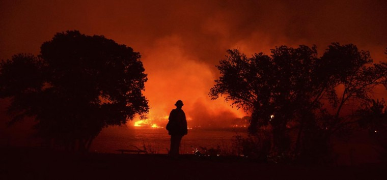Firefighters battle the Powerhouse wildfire at the Angeles National Forest, with the fire now having destroyed several homes near the Lake Hughes area in California June 1, 2013. The Powerhouse Fire remained at 15 percent containment after ravaging over 5,600 acres of the forest by Saturday evening. (Gene Blevins/Reuters)