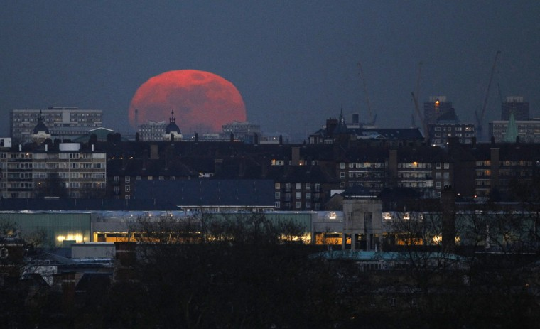 "The moon rises over east London March 19, 2011. Saturday will see the rise of a full moon called a ""supermoon"" when it arrives at its closest point to the Earth in 2011, a distance of 221,565 miles or 356,575 kilometers away. (Suzanne Plunkett/Reuters)"