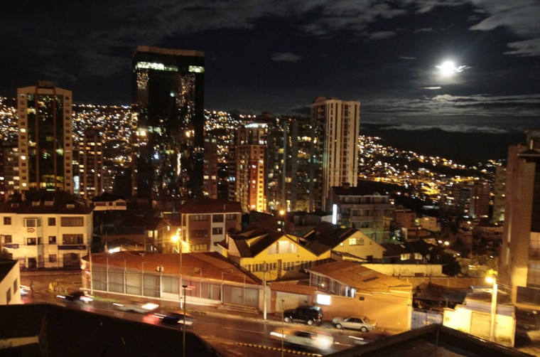 "The moon is seen over La Paz city March 19, 2011. Saturday sees the rise of a full moon called a ""supermoon"" where it arrives at its closest point to the Earth in 2011, a distance of 221,565 miles or 356,575 km away. (David Mercado/Reuters)"