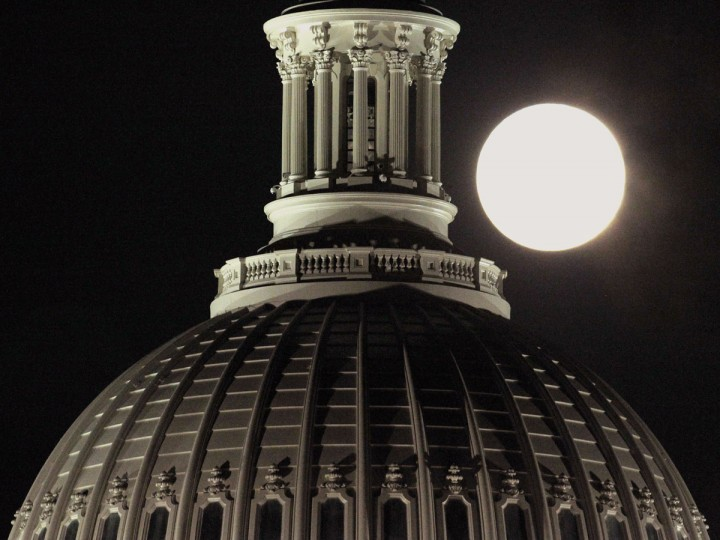 "The full moon rises behind the U.S. Capitol Dome in Washington March 19, 2011. Saturday saw the rise of a full moon called a ""supermoon"" when it arrived at its closest point to the Earth in 2011, a distance of 221,565 miles or 356,575 km away. (Hyungwon Kang/Reuters)"