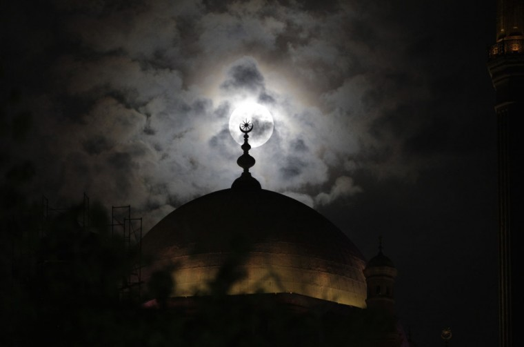 A full moon known as the supermoon is seen behind the minaret of Mohamed Ali mosque, in Islamic Cairo, May 5, 2012. (Asmaa Waguih/Reuters)