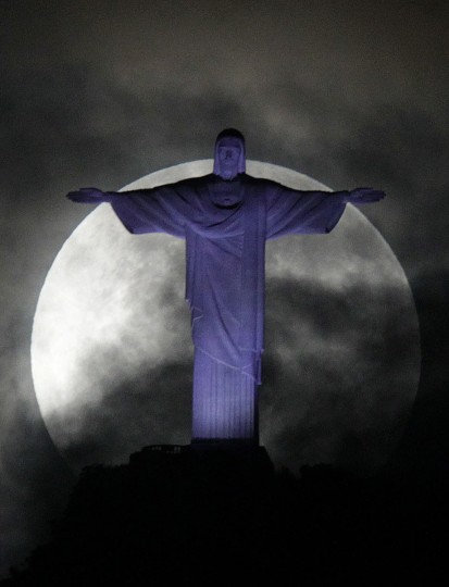 "The full ""supermoon,"" scientifically known as a ""perigee moon,"" is pictured over the Christ the Redeemer statue in Rio de Janeiro May 6, 2012. (Ricardo Moraes/Reuters)"