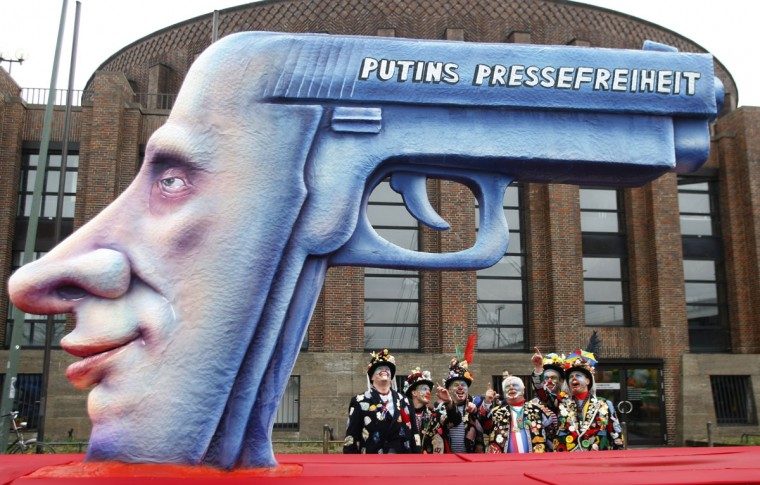 February 23, 2009: Revellers stand next to a carnival float with a large papier-mache figure of a gun as Russia's Prime Minister Vladimir Putin, with 'freedom of press' written on it, is pictured during the traditional Rose Monday carnival parade in Duesseldorf, Germany. The Rose Monday parades in Cologne, Mainz and Duesseldorf are the highlight of the German street carnival season. (Ina Fassbender/Reuters)
