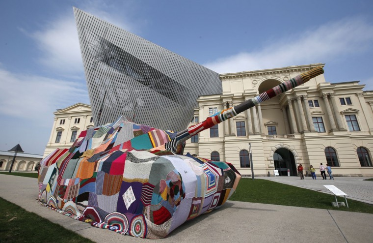 "April 25, 2013: A German Leopard 1 tank stands in front of the Museum of Military History in Dresden, Germany. The tank is covered with knitting made by Dresden citizens, called ""Attack! Knitting for peace. Taking a stand against war and violence with a cross-generational handicrafts project."" (Fabrizio Bensch/Reuters)"