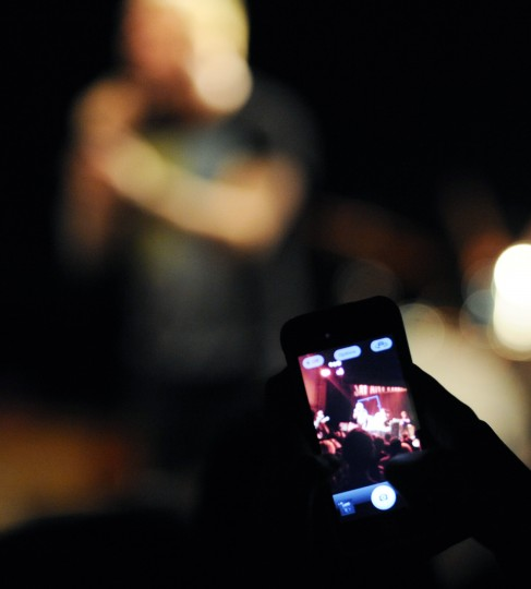 A member of the crowd snaps a photo on their smart phone of the Say Anything show. (Jon Sham/BSMG)