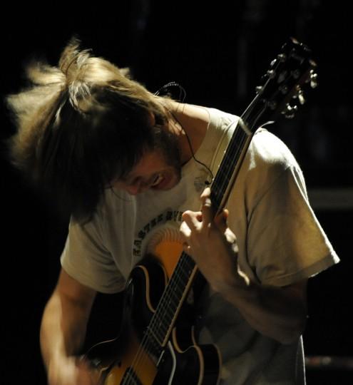 Jeff Turner bangs his head while jamming. (Jon Sham/BSMG)