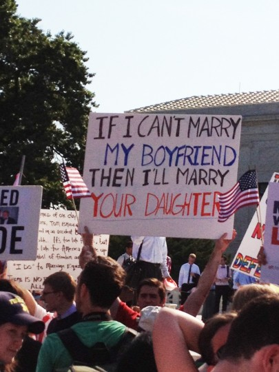 Gay marriage supporters wait outside the U.S. Supreme Court building in Washington D.C. ahead of Supreme Court decisions on the DOMA and Prop 8. (Credit: Flannery Sullivan)
