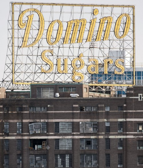 An explosion at the Domino refinery in 2007 damages the historic building, but its famed neon sign survived. (Gene Sweeney Jr./Baltimore Sun Photo)