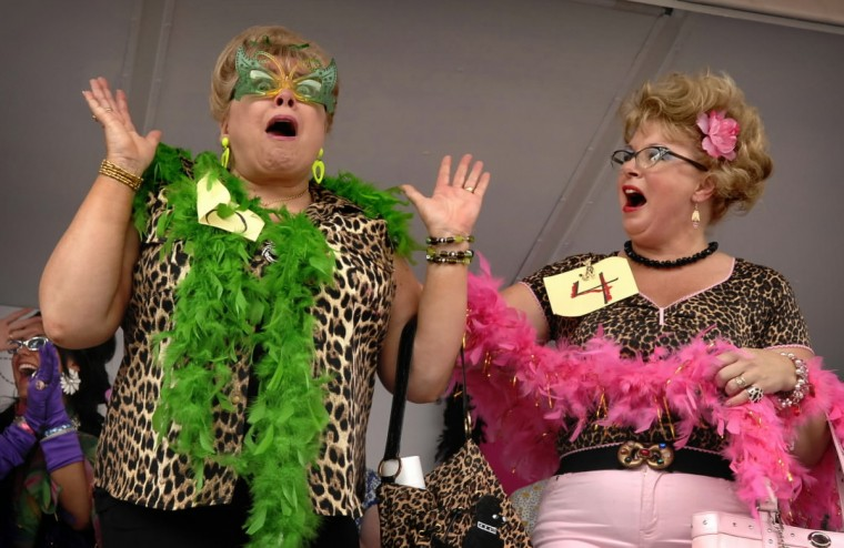 "Elliana Fetsko, whose nickname is ""Crabcakes,"" left, reacts to the news that she has been crowned the 2007 ""Bawlmer's Best Hon,"" at the 14th annual Honfest in Hampden, as the second place winner, Sanni Puhl, right, congratulates her. (Amy Davis/Baltimore Sun)"