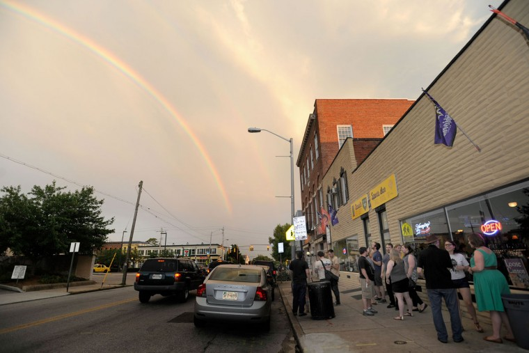 Patrons check out a rainbow outside David's 1st and 10 Sports Bar in Hampden. (Steve Ruark for The Baltimore Sun)