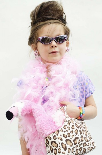 "Honfest — June 8, 2013: Maddie Meisinger, 4, of Lutherville and her buddie ""Rosie Pie"" the flamingo, hoped to charm the judges. (J.M. Giordano for The Baltimore Sun)"