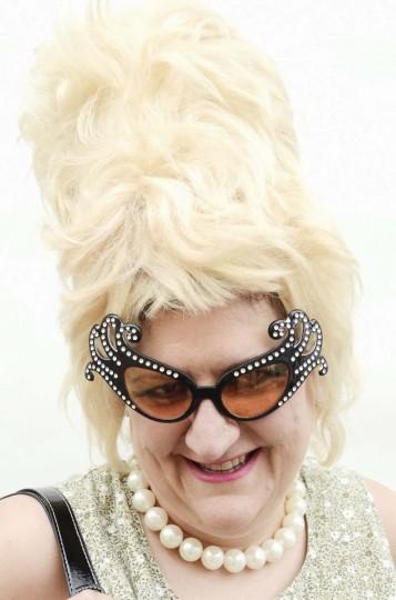 Honfest — June 8, 2013: Karen Bullard, 48, of Carroll County, showed off her big wig at Honfest. (J.M. Giordano for The Baltimore Sun)