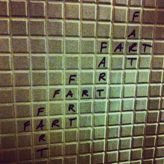 """Interesting Scrabble-like graffiti in a fancy restaurant bathroom"" - The Waterfront, November 19, 2012 (Nick Tann/Baltimore Sun)"