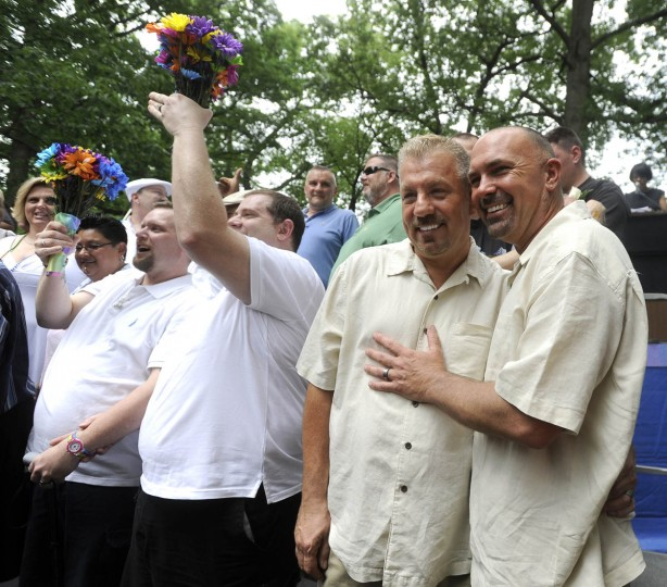 Just-married couple Larry Knight, center left, and Ronald Foit, right, pose for a celebratory photo after the mass same-sex wedding ceremony. They are from Baltimore. (Barbara Haddock Taylor/Baltimore Sun)