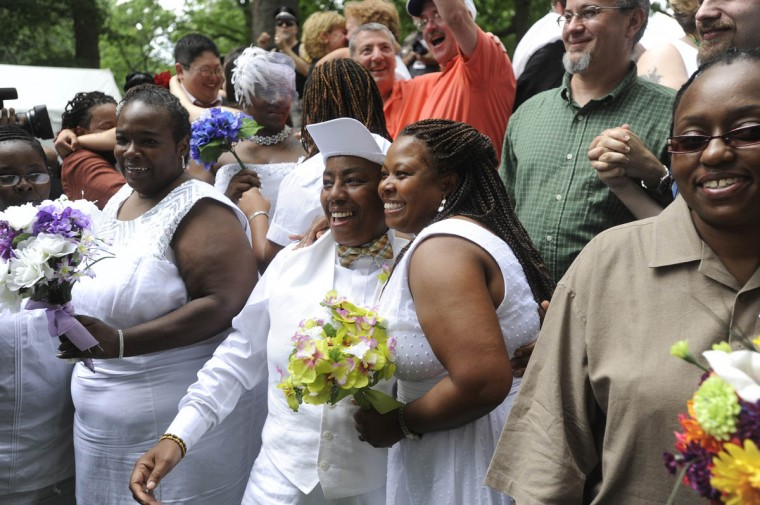 Rhoda Blocker, center left, and Allison Fisher smile after taking their wedding vows. Baltimore Mayor Stephanie Rawlings Blake conducted a same-sex wedding ceremony this afternoon in Druid Hill Park during the Baltimore Pride Festival. (Barbara Haddock Taylor/The Baltimore Sun)