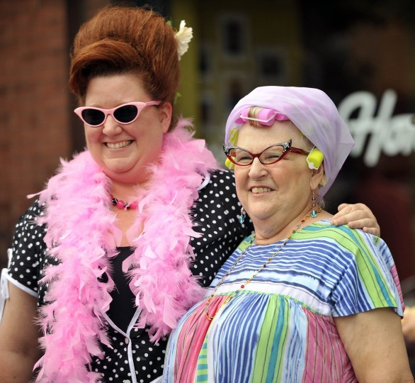 Ronda Sharman, Upper Marlboro and her mother, Joan Sharman, Hughesville, pose for photos outside Cafe Hon. Joan was born and grew up in Baltimore. They are attending Honfest 2011. (Kim Hairston/Baltimore Sun)