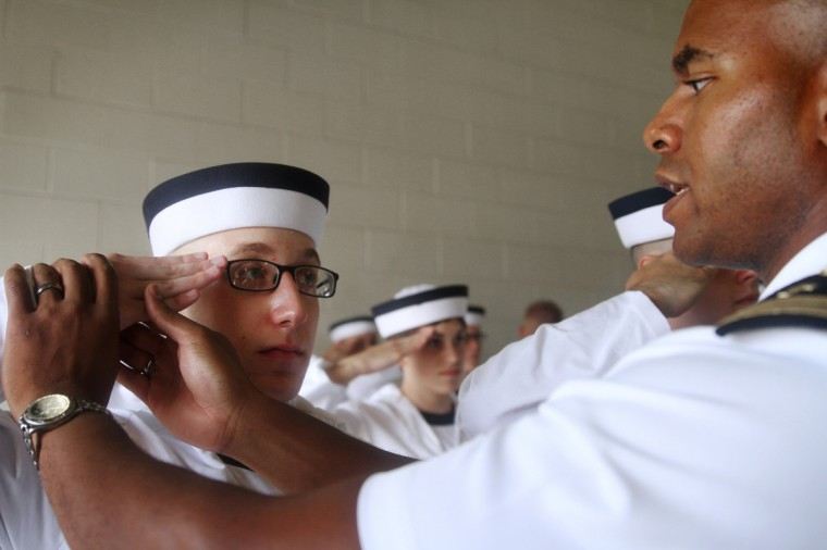 Lieutenant Madison Carter helps perfect Midshipman Woods' salute at the Naval Academy's Induction Day. (Erin Kirkland/Baltimore Sun)