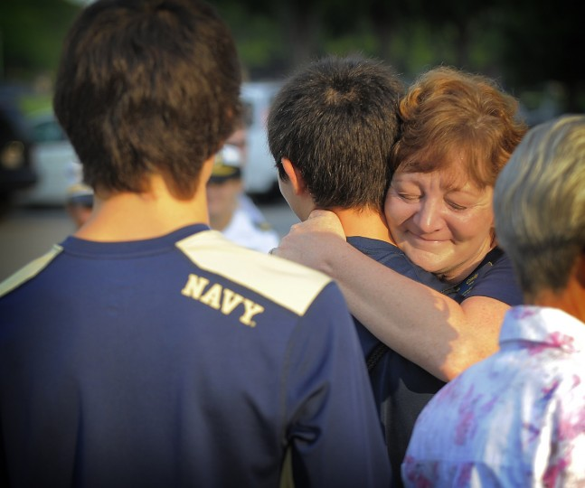 Cindy Tang of Malvern, PA, hugs her son Jonathan goodbye at the Naval Academy's Induction Day which marks the beginning of the seven week plebe training for the incoming class of 2017. (Erin Kirkland/Baltimore Sun)