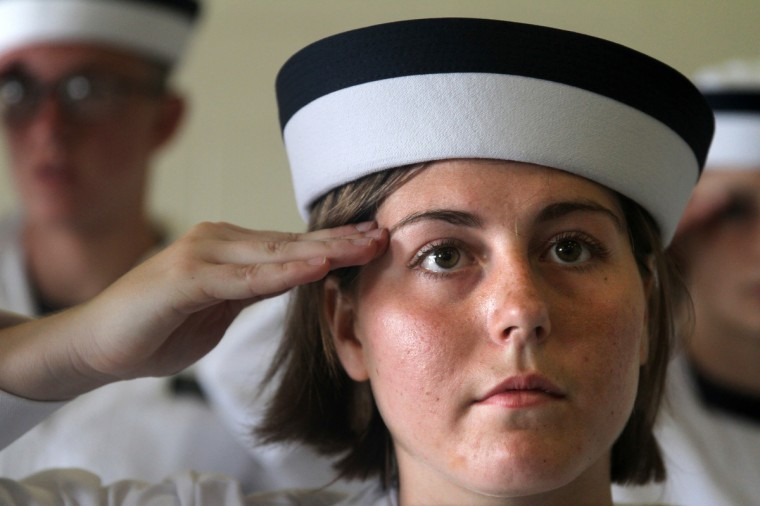 Midshipman Scrudato salutes her commanding officers at the Naval Academy's Induction Day. (Erin Kirkland/Baltimore Sun)