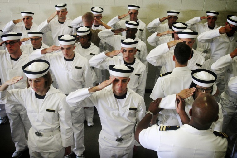 Lieutenants help plebes learn how to properly salute at the Naval Academy's Induction Day which marks the beginning of the seven week plebe training for the incoming class of 2017. (Erin Kirkland/Baltimore Sun)