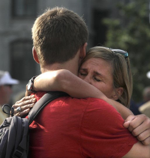 Annie Davis of Colorado hugs her son Scotty just before he reported for the Naval Academy's Induction Day. Scotty's brother, Eric, is a member of the Academy's 2016 class. (Erin Kirkland/Baltimore Sun)