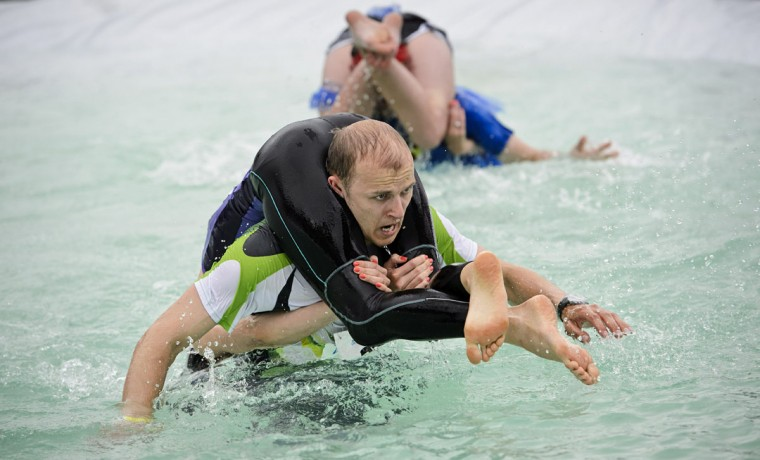 Alar Voogla and Kristi Viltrop from Estonia compete to finish second in the Wife Carrying World Championships in Sonkajarvi, Finland on July 6, 2013. (Roni Rekomaa/ AFP Photo)