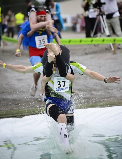 Alar Voogla and Kristi Viltrop from Estonia compete to finish second in the Wife Carrying World Championship competition in Sonkajarvi July 6, 2013.(Roni Rekomaa/ AFP Photo)
