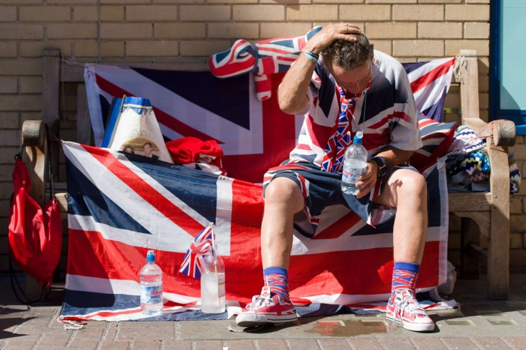Royal supporter Terry Hutt cools off in the mid-afternoon heat outside the Lindo Wing of St Mary's Hospital in London, on July 19, 2013, where Prince William and his wife Catherine's baby is expected to be born. The long wait for the birth of Britain's royal baby is record business for bookmakers, as punters worldwide bet on a girl called Alexandra to be born any day now. (Leon Neal / AFP / Getty Images)