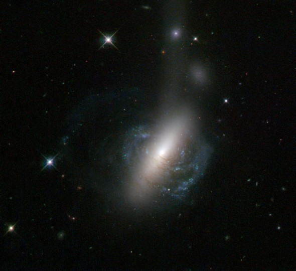 This new image from the NASA/ESA Hubble Space Telescope captures an ongoing cosmic collision between two galaxies — a spiral galaxy is in the process of colliding with a lenticular galaxy. (Photo courtesy of European Space Agency/NASA/Hubble)