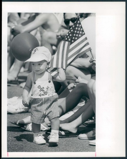 1990: Brent Campbell, who was born on the fourth last year, celebrates his birthday by lining the sidewalk to watch the Catonsville parade. (Kenneth K. Lam/Baltimore Sun)