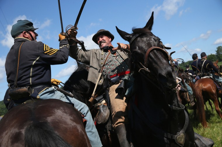 Union and Confederate re-enactors skirmish during a re-enactment of the Battle of Gettysburg on June 29, 2013 in Gettysburg, Pennsylvania. (John Moore/Getty Images)