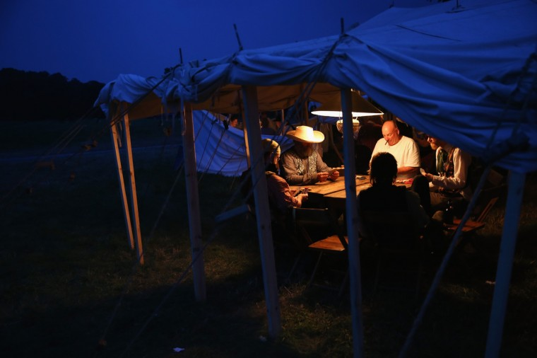 American Civil War re-enactors play poker while taking a break from a three-day Battle of Gettysburg re-enactment on June 29, 2013 in Gettysburg, Pennsylvania. (John Moore/Getty Images)