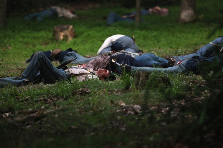 """Civil War re-enactors from Hood's Texas Brigade lie where they were """"shot"""" as part of a three-day Battle of Gettysburg re-enactment on June 29, 2013 in Gettysburg, Pennsylvania. (John Moore/Getty Images)"""