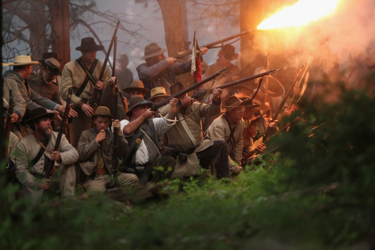 Confederate Civil War re-enactors launch an evening attack during a three-day Battle of Gettysburg re-enactment on June 29, 2013 in Gettysburg, Pennsylvania. (John Moore/Getty Images)
