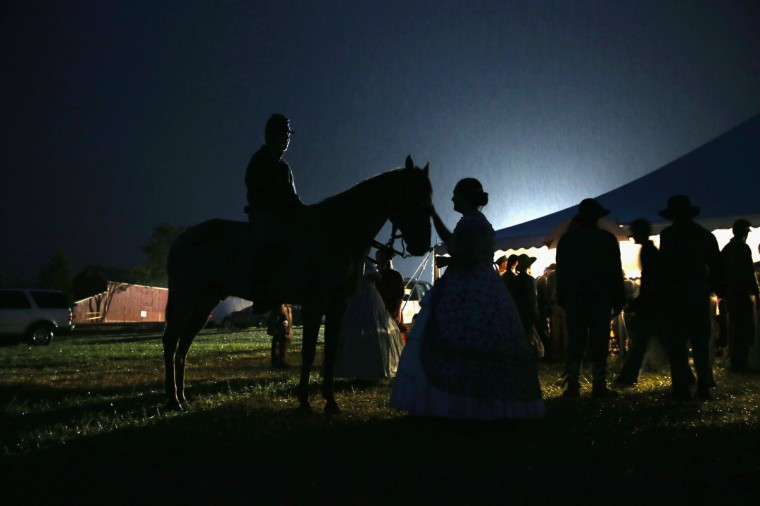 Re-enactors meet in the rain while taking a break from a three-day Battle of Gettysburg re-enactment on June 29, 2013 in Gettysburg, Pennsylvania. (John Moore/Getty Images)