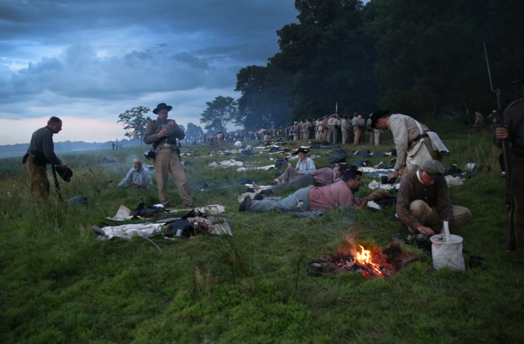 Civil War re-enactors from Hood's Texas Brigade rest in camp during a three-day Battle of Gettysburg re-enactment on June 29, 2013 in Gettysburg, Pennsylvania. (John Moore/Getty Images)