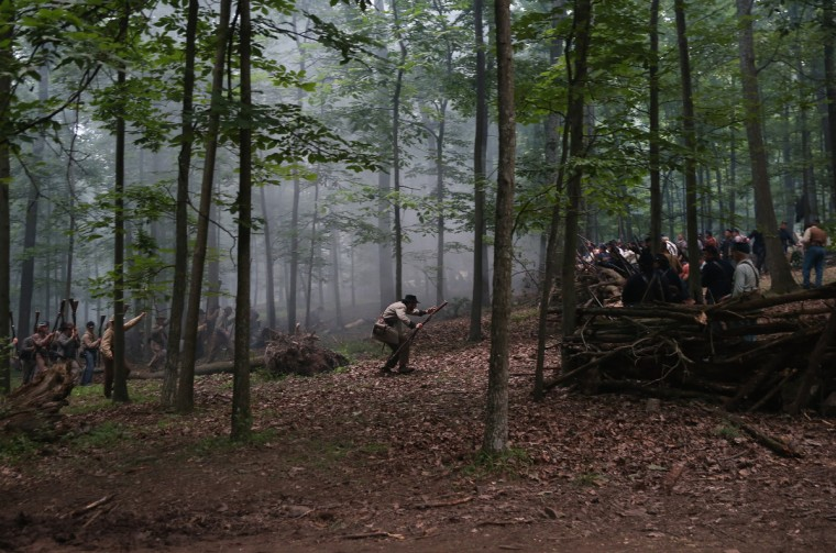 Confederate Civil War re-enactors from Hood's Texas Brigade (L), surrender to Union troops as part of a three-day Battle of Gettysburg re-enactment on June 29, 2013 in Gettysburg, Pennsylvania. (John Moore/Getty Images)