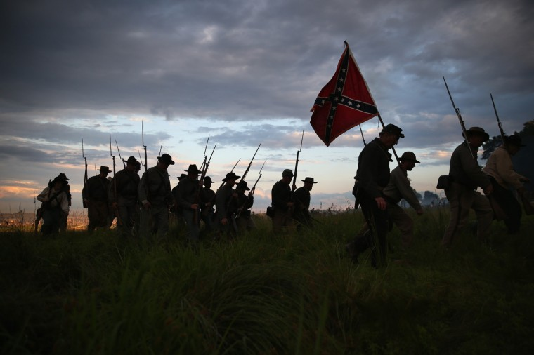 Confederate Civil War re-enactors march for an evening attack during a three-day Battle of Gettysburg re-enactment on June 29, 2013 in Gettysburg, Pennsylvania. (John Moore/Getty Images)