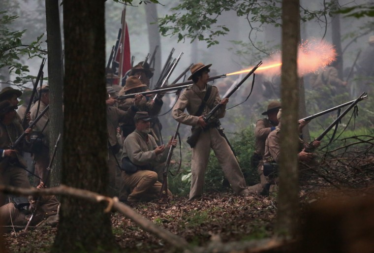 Confederate Civil War re-enactors from Hood's Texas Brigade launch an evening attack on Union troops as part of a three-day Battle of Gettysburg re-enactment on June 29, 2013 in Gettysburg, Pennsylvania. (John Moore/Getty Images)