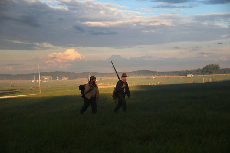 Civil War re-enactors walk at sunset during a three-day Battle of Gettysburg re-enactment on June 29, 2013 in Gettysburg, Pennsylvania. (John Moore/Getty Images)