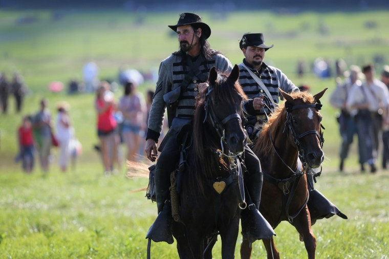 Confederate Civil War re-enactors ride after re-enacting part of a three-day Battle of Gettysburg re-enactment on June 29, 2013 in Gettysburg, Pennsylvania. (John Moore/Getty Images)