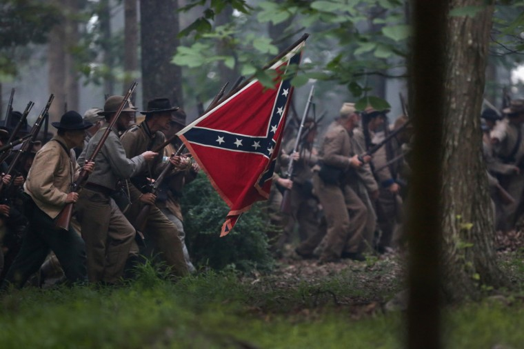 Civil War re-enactors from Hood's Texas Brigade launch an evening attack as part of a three-day Battle of Gettysburg re-enactment on June 29, 2013 in Gettysburg, Pennsylvania. (John Moore/Getty Images)