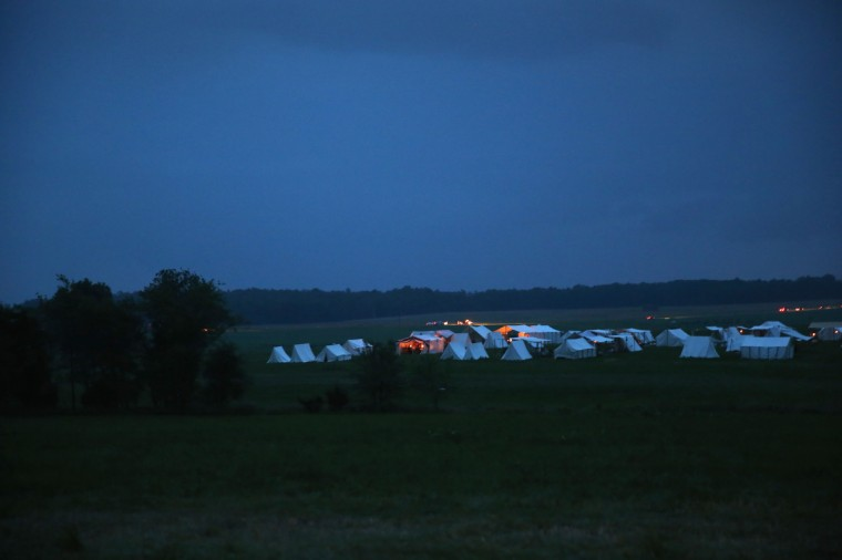 Tents shelter Confederate Civil War re-enactors from an evening rain storm during the three-day Battle of Gettysburg re-enactment on June 29, 2013 in Gettysburg, Pennsylvania. (John Moore/Getty Images)