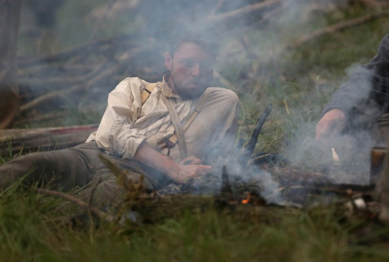 Civil War re-enactors prepare a meal during a three-day Battle of Gettysburg re-enactment on June 29, 2013 in Gettysburg, Pennsylvania. (John Moore/Getty Images)
