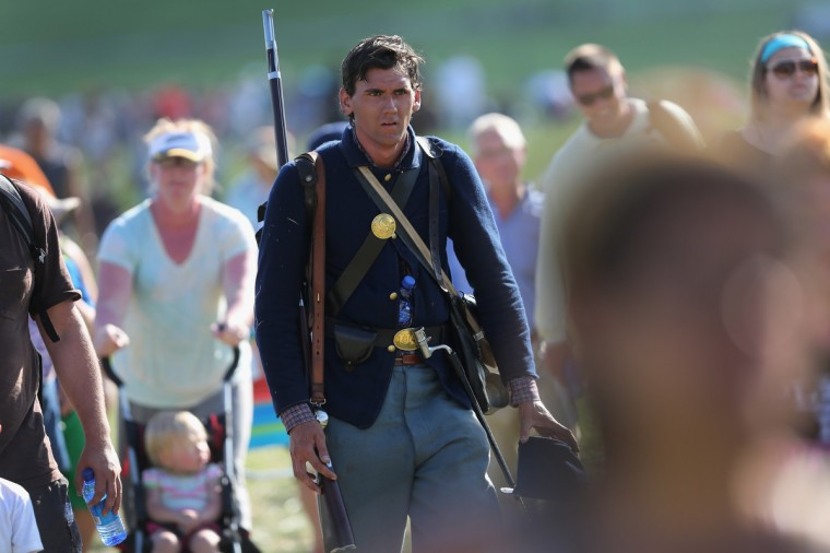 A Union Civil War re-enactor walks with spectators after taking part in a three-day Battle of Gettysburg re-enactment on June 29, 2013 in Gettysburg, Pennsylvania. (John Moore/Getty Images)