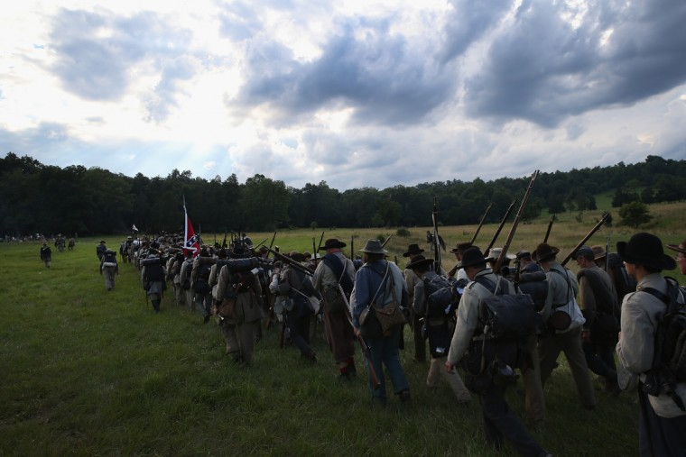Confederate Civil War re-enactors from Hood's Texas Brigade march into position for an evening attack on Union troops as part of a three-day Battle of Gettysburg re-enactment on June 29, 2013 in Gettysburg, Pennsylvania. (John Moore/Getty Images)