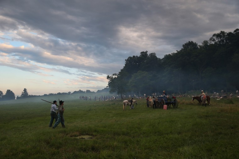 Civil War re-enactors from Hood's Texas Brigade return to camp at sunset during a three-day Battle of Gettysburg re-enactment on June 29, 2013 in Gettysburg, Pennsylvania. (John Moore/Getty Images)