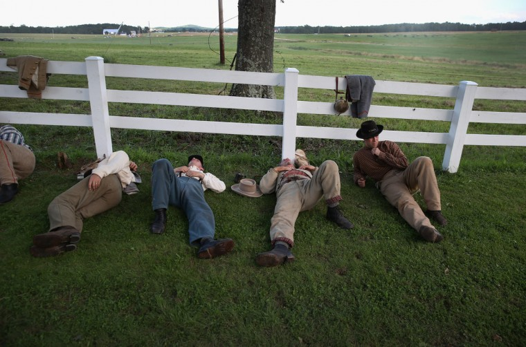 Confederate Civil War re-enactors rest during a break in the three-day Battle of Gettysburg re-enactment on June 29, 2013 in Gettysburg, Pennsylvania. (John Moore/Getty Images)